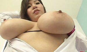 Big tit nurse showing off her large racks and rubbing her slit