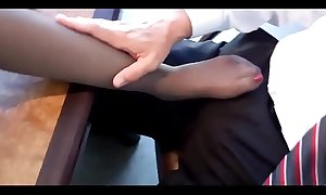 Mom in black pantyhose gives footjob to school principal in his office - more footjobs on SweetNylonFeet.com