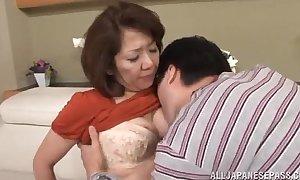 Japanese mature kisses her stud